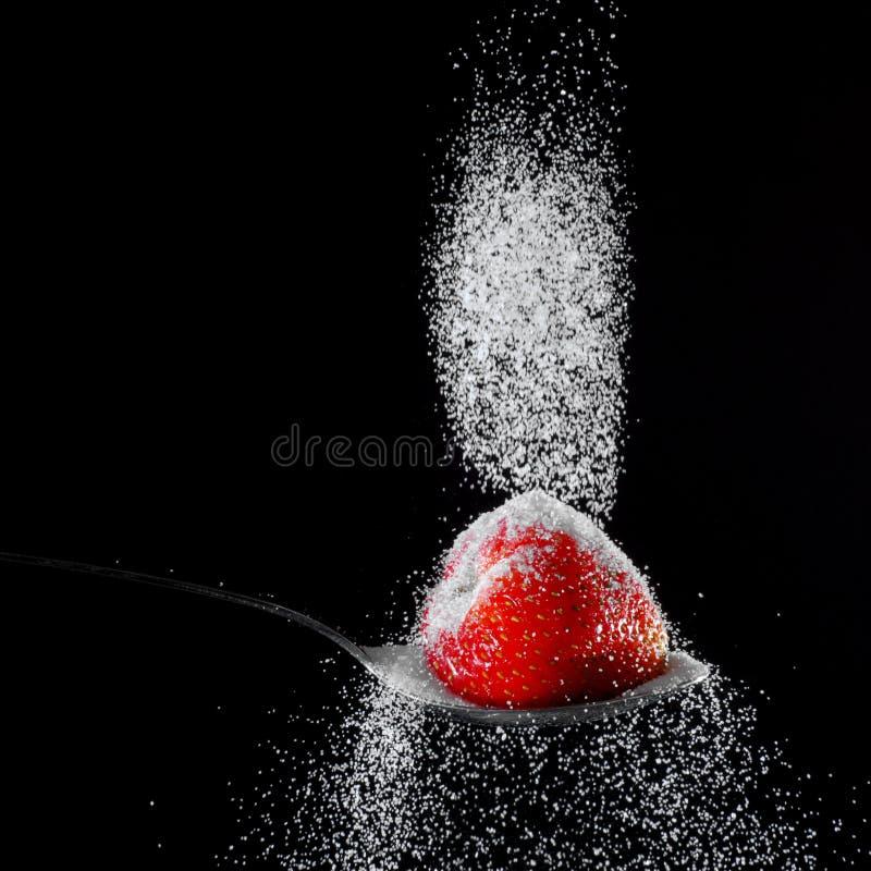 Erdbeere und Zucker lizenzfreies stockbild