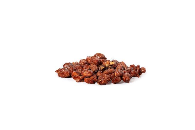 Erdnüsse in Karamel- und Sesamsamen Auf weißem Hintergrund isoliert stockfoto
