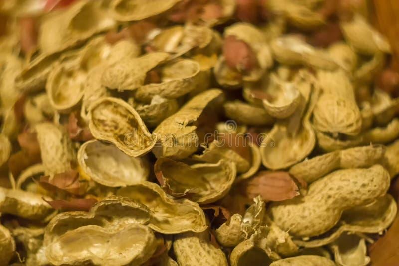 Erdnüsse und Oberteillebensmittelhintergrundbeschaffenheit stockfoto