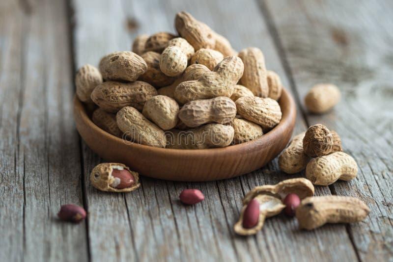 Erdnuss in der Oberteilbeschaffenheit und -hintergrund Erdnussbeschaffenheit Geschälte Erdnüsse Gesunde Nahrung Schließen Sie her stockfotos