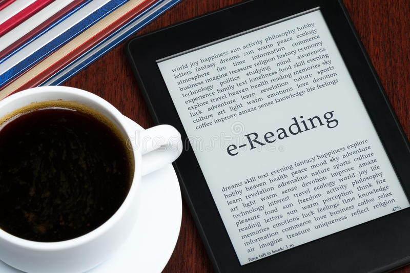 EReader. EReading: eBook reader and a cup of coffee stock image