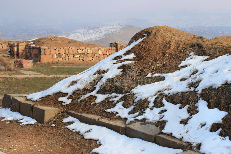 Erebuni Fortress (Armenia) in winter. Erebuni Fortress (also known as Arin Berd -Fortress of Blood) is an Urartian fortified city, located in Yerevan, Armenia royalty free stock images