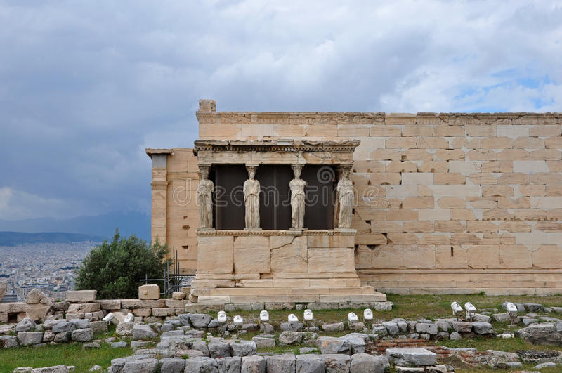 Erechtheion caryatids. Porch of the Caryatids exterior view of Erechtheion ancient temple ruins at the Acropolis, Athens Greece royalty free stock photo