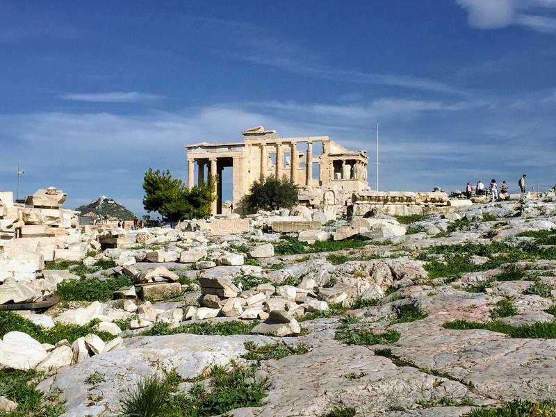 The Erechtheion , Greece. The Erechtheion or Erechtheum is an ancient Greek temple on the north side of the Acropolis of Athens in Greece which was dedicated to royalty free stock photo