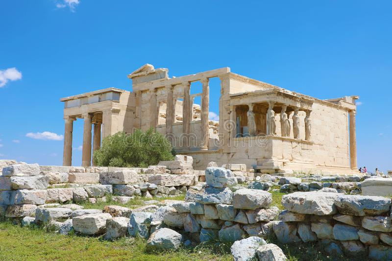 Erechtheion temple with Caryatid Porch on the Acropolis, Athens, Greece. Famous Acropolis hill is a main landmark of Athens. stock photos