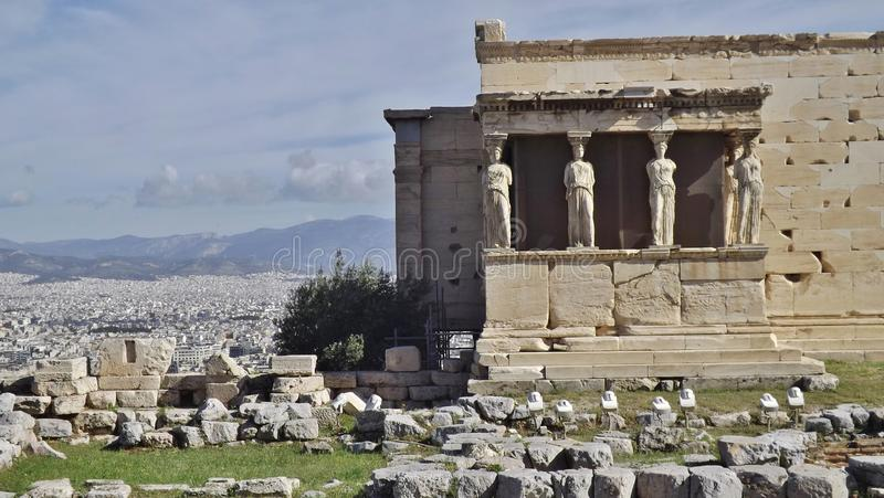 The Erechtheum on the Acropolis, Athens, Greece. Panoramic view with Athens and the mountains in the Background royalty free stock photography