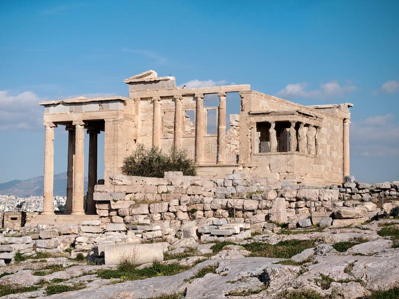 The Erechtheum with Caryatids in Acropolis. The Erechtheum with caryatids near Parthenon temple in Acropolis hill stock photos