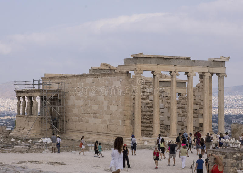 The Erechtheum, a Greek Temple. The famous Porch of the Maidens with six draped female figures caryatids as supporting columns is located on the north side of stock photos