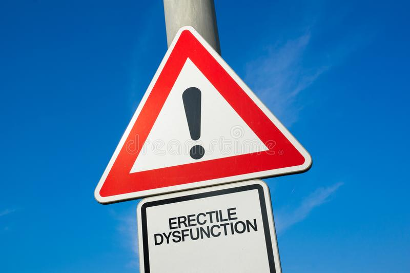 Erectile dysfunction and impotence. Erectile dysfunction - traffic sign with exclamation mark to alert, warn caution - incapability and failure of man / male to royalty free stock image
