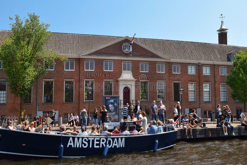 Eremo Amsterdam sulle banche del fiume di Amstel, Paesi Bassi fotografia stock libera da diritti