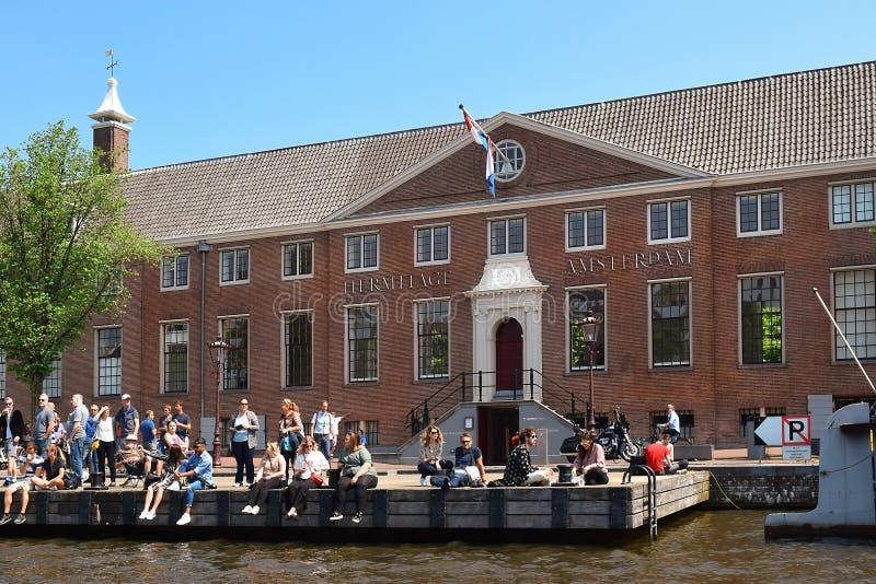 Eremo Amsterdam sulle banche del fiume di Amstel, Paesi Bassi fotografie stock