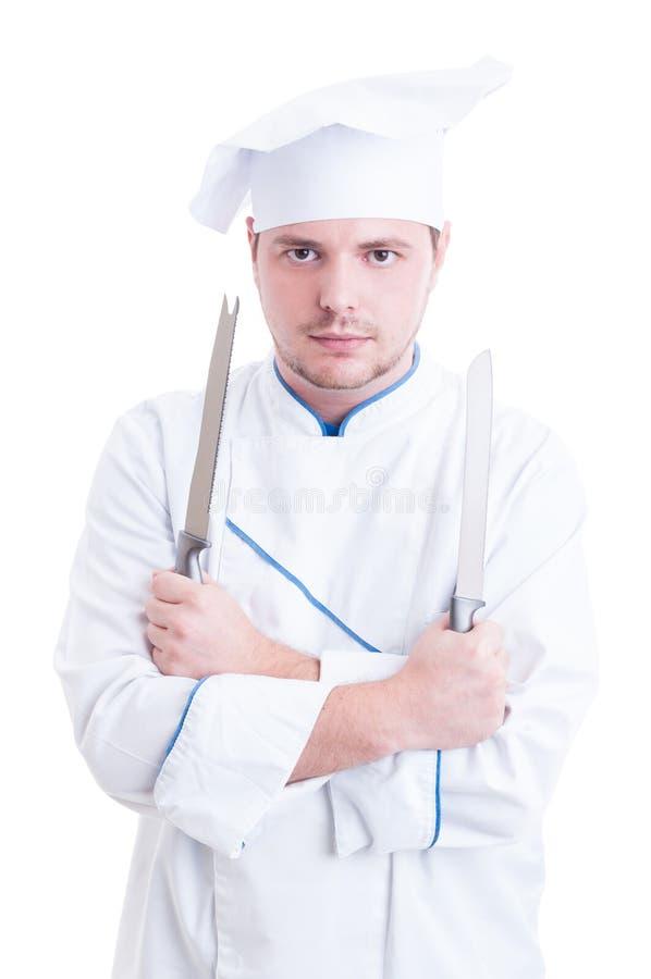 Erfahrener Chef oder Koch, die zwei Messer oder Blätter halten stockfotografie