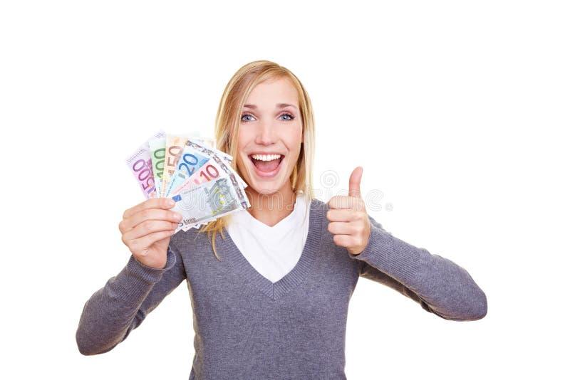 Erfolgreiche Frau mit Geld lizenzfreie stockfotos