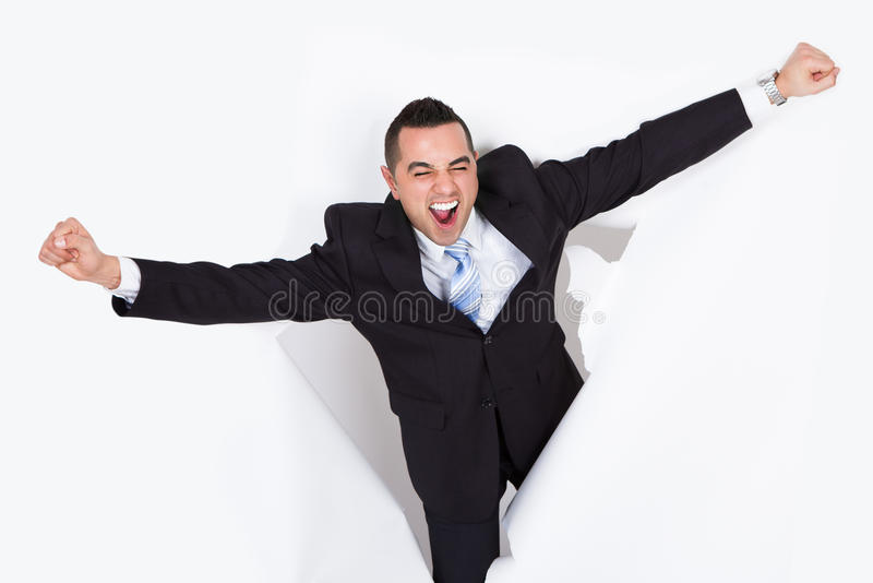 Erfolgreiche Geschäftsmann-Breaking Through White-Wand stockbilder
