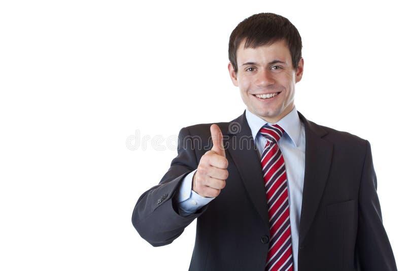 Erfolgreicher junger Geschäftsmann hält Daumen hoch. stockbilder