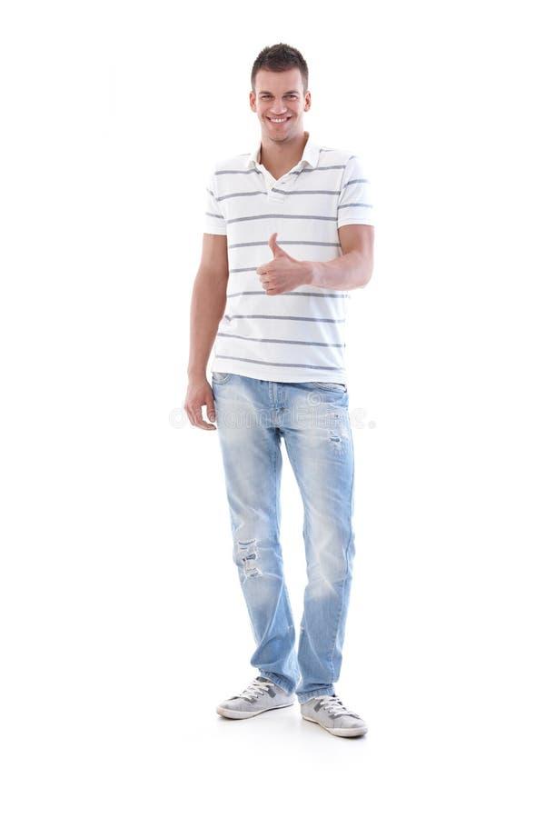 Erfolgreiches Lächeln des jungen Mannes lizenzfreie stockbilder