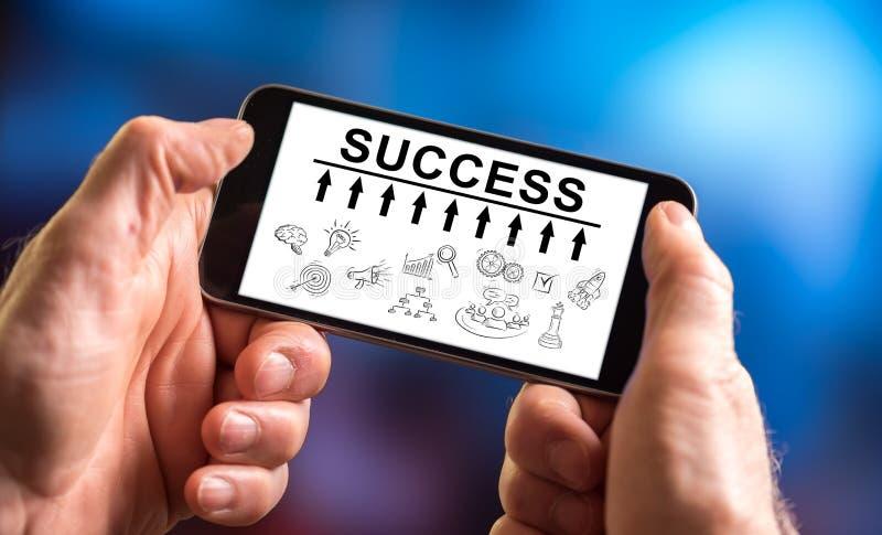 Erfolgskonzept auf einem Smartphone lizenzfreie stockfotografie