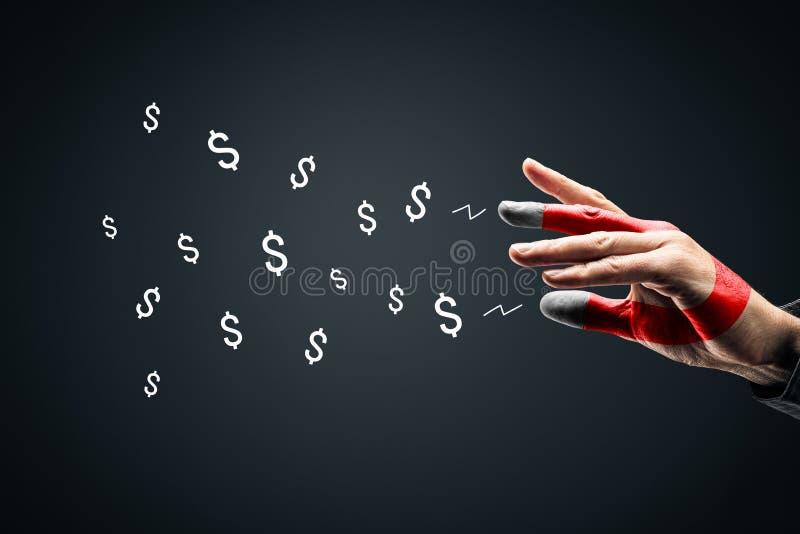 Erfolgskonzept für Finanzmärkte - Magnet für Geld stockfotografie
