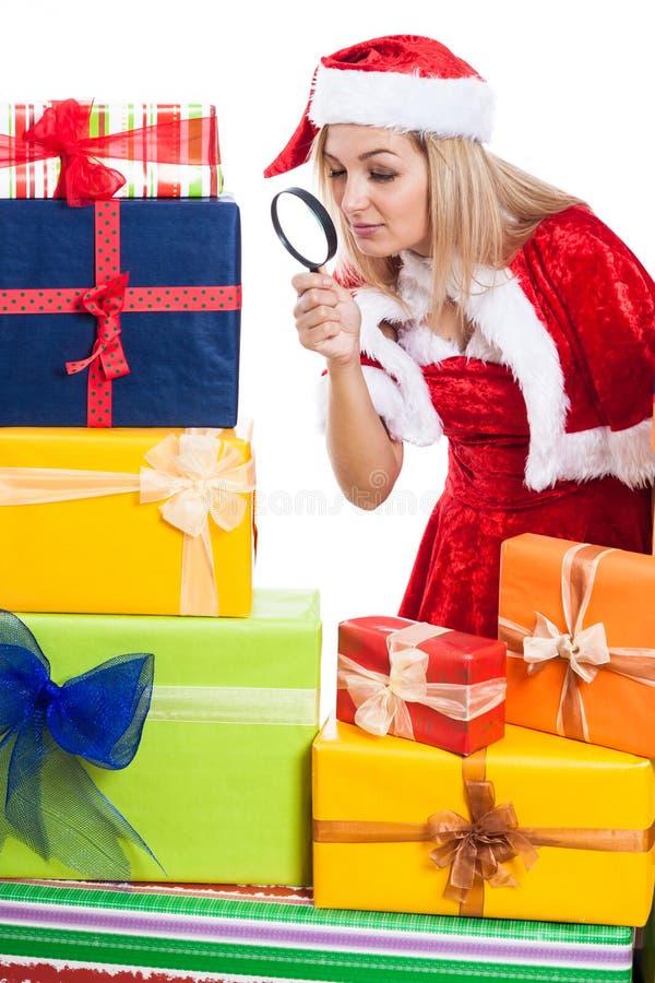 Erforschungsgeschenk der Weihnachtsfrau stockfotografie