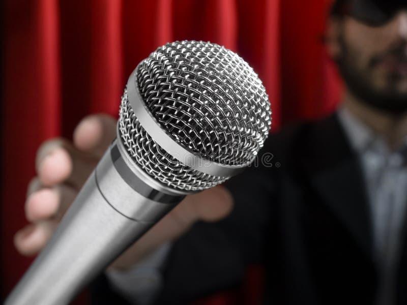 Ergreifen Sie den mic stockfotos