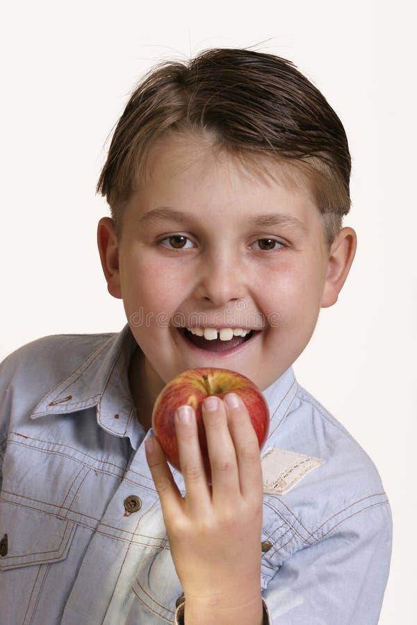 Download Ergreifen Sie einen Apfel stockbild. Bild von gesund, zicklein - 29535