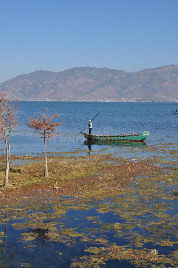 Erhai Lake in Yunnan, China fishing boat people. ãEUR,Erhai Lake in ancient literature has called elm leaf Ze Kun Mi Chuan , Xierhe , West Second River royalty free stock images