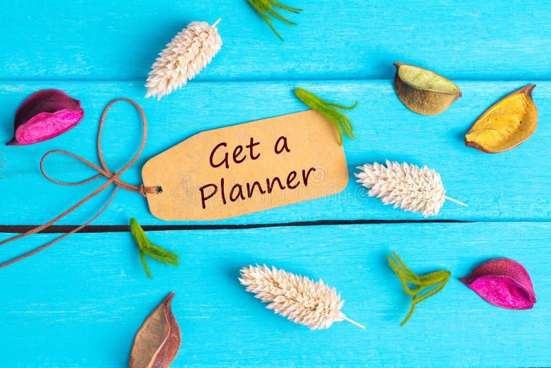 Erhalten Sie einen Planertext auf Papiertag lizenzfreie stockbilder