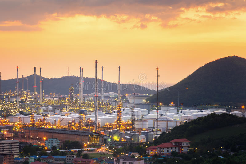 Erial view oil refinery night with mountain background during twilight,Industrial zone royalty free stock photos