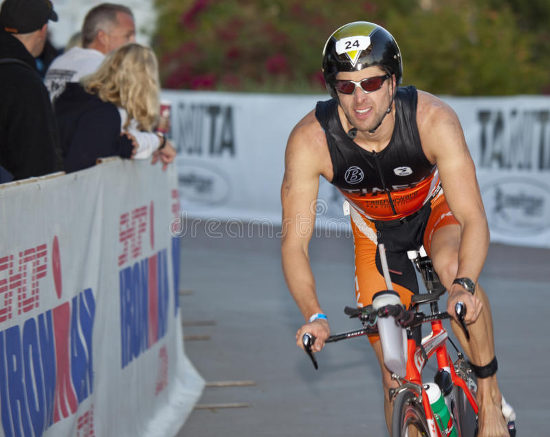 Eric Bean Racing in the Arizona Ironman Triathlon. TEMPE, AZ - NOV. 22: Eric Bean (who finished 6th overall) in the cycling stage of the Phoenix Ironman royalty free stock photography