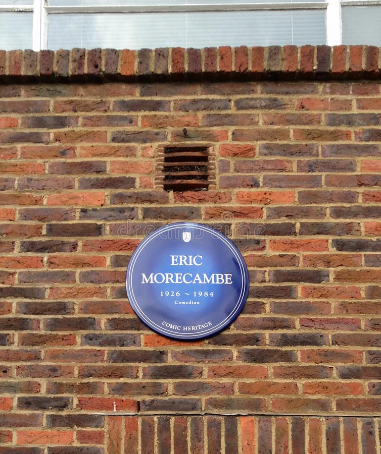 Eric Morecambe Plaque. Teddington, United Kingdom - July 05 2012:   A blue plaque placed by the Comic Heritage group to commemorate Eric Morecambe at the now royalty free stock photography