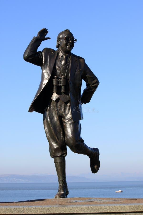 Eric Morecambe staty på Morecambe promenad. arkivbild