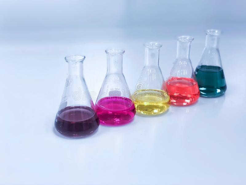 The Erlenmeyer or Conical flask on bench laboratory, with colorful solvent solution from titration experiment, acidity, alkalinity. And total hardness analysis stock photo