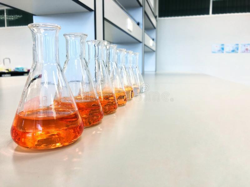 The Erlenmeyer or Conical flask on bench laboratory, with gradient solvent for analysis concentration range of total iron. The Erlenmeyer or Conical flask on royalty free stock photography