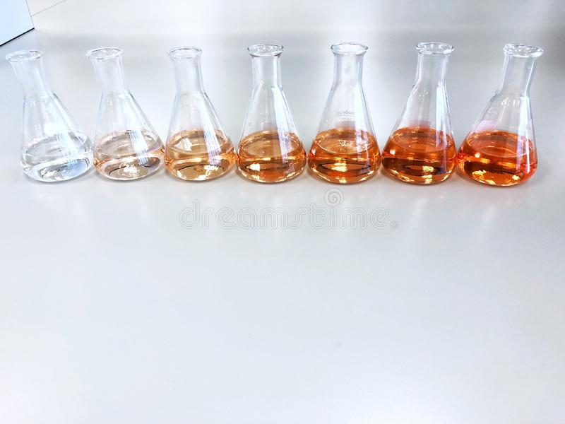 The Erlenmeyer or Conical flask on bench laboratory, with gradient solvent for analysis concentration range of total iron. The Erlenmeyer or Conical flask on royalty free stock images