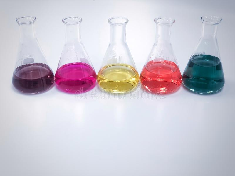 The Erlenmeyer or Conical flask in line on bench laboratory, with colorful solvent from titration experiment, acidity, alkalinity. The Erlenmeyer or Conical stock photography