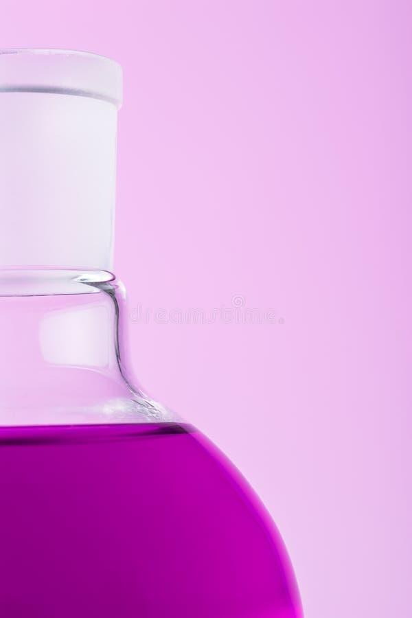 Erlenmeyer flask. Close up of erlenmeyer flask over pink background stock image