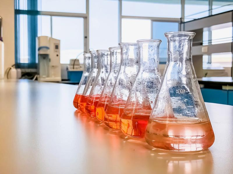 The Erlenmeyer flask in the line with color range solvent using for analysis calibration curve of iron in waste water sample. The experiment in chemistry royalty free stock photography