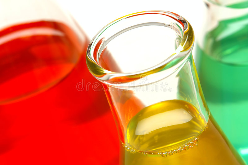 Erlenmeyer Flasks in Science Research Lab. Laboratory glass conical Erlenmeyer flasks filled with liquid for an experiment in a science research lab stock photos