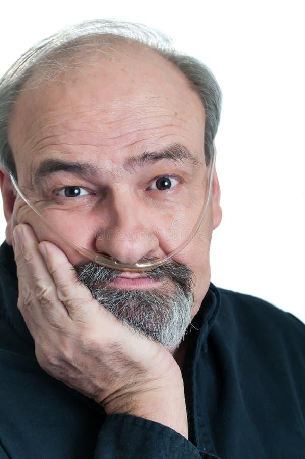 Ermüdeter Mann mit Atmungsunfähigkeit stockbilder