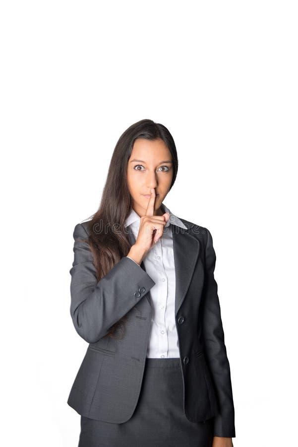 Ernste junge Geschäftsfrau, die um Ruhe bittet lizenzfreies stockbild