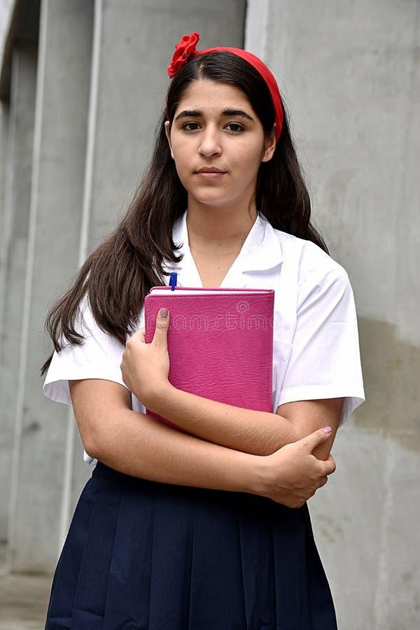 Ernste katholische kolumbianische Studentin Wearing Uniform stockfoto