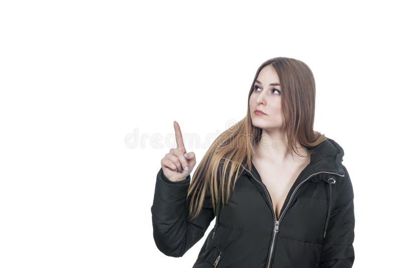 Ernste sexy Frau in den Mantelpunkten oben lizenzfreie stockfotos