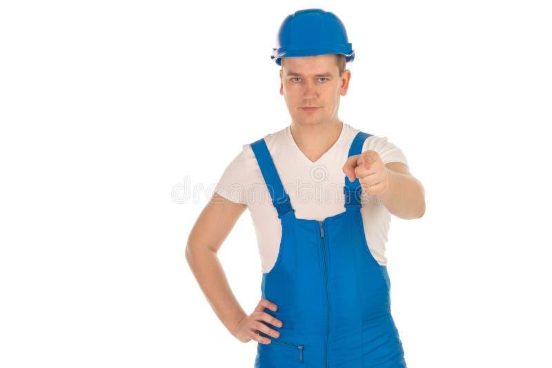 Ernster Erbauer des jungen Mannes in der blauen Uniform lizenzfreie stockfotos