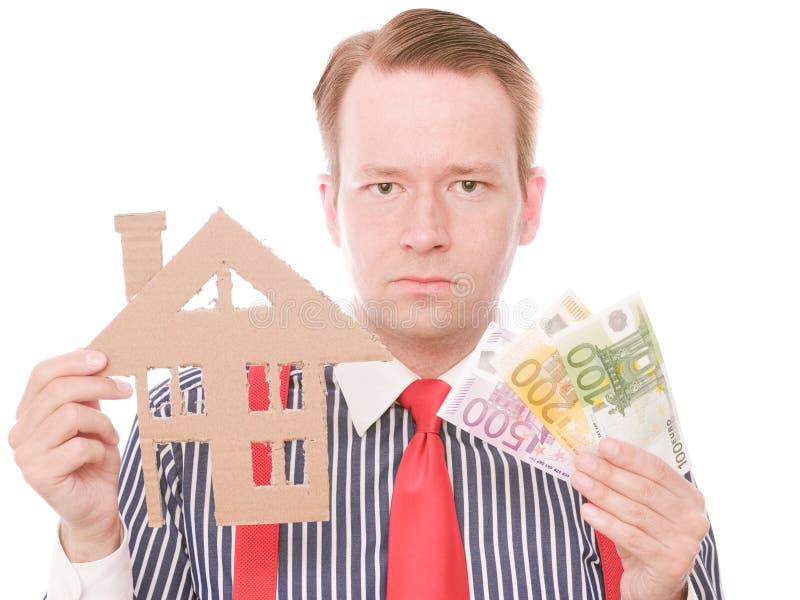 Ernster Geschäftshauseigentümer mit Geld lizenzfreies stockbild