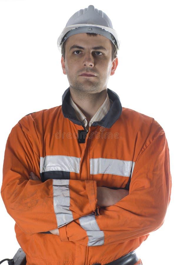 Ernstes Arbeitskraftportrait getrennt auf Weiß lizenzfreies stockfoto
