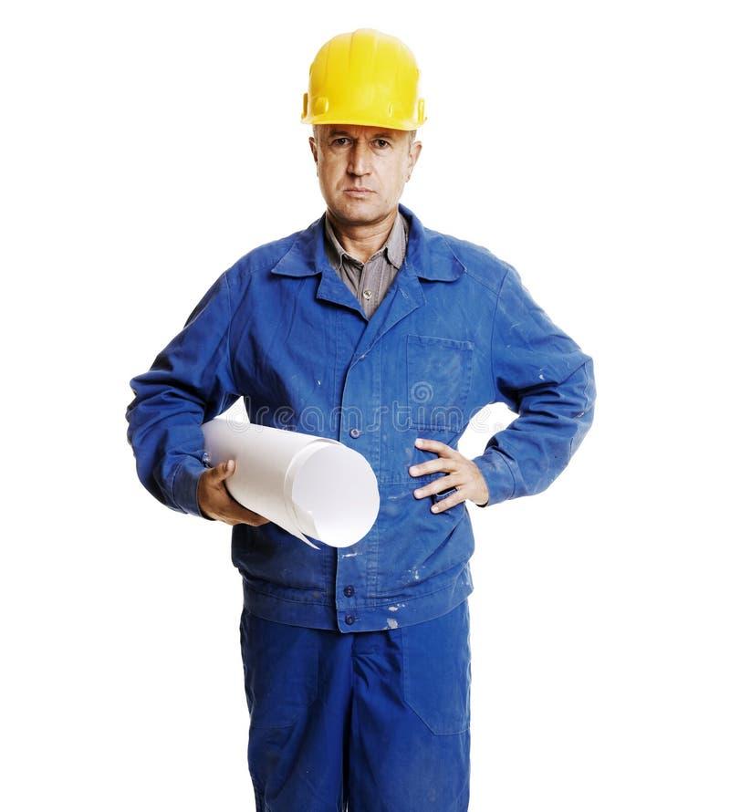 Ernstige arbeider met blauwdrukken stock foto's