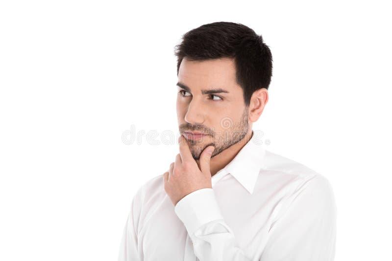 Ernstige en peinzende geïsoleerde jonge zakenman die zijdelings kijken stock afbeelding