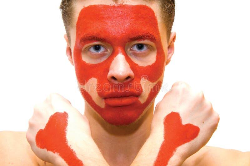 Ernstige mens met geschilderd gezicht stock fotografie