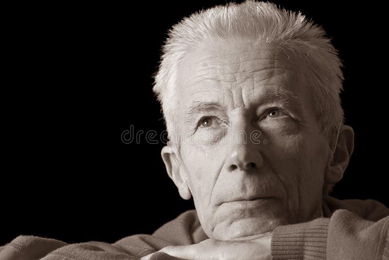 Ernstige oudere mens in sepia royalty-vrije stock foto's