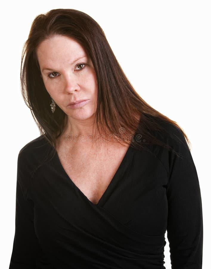 Ernstige Vrouw in Zwarte royalty-vrije stock afbeelding
